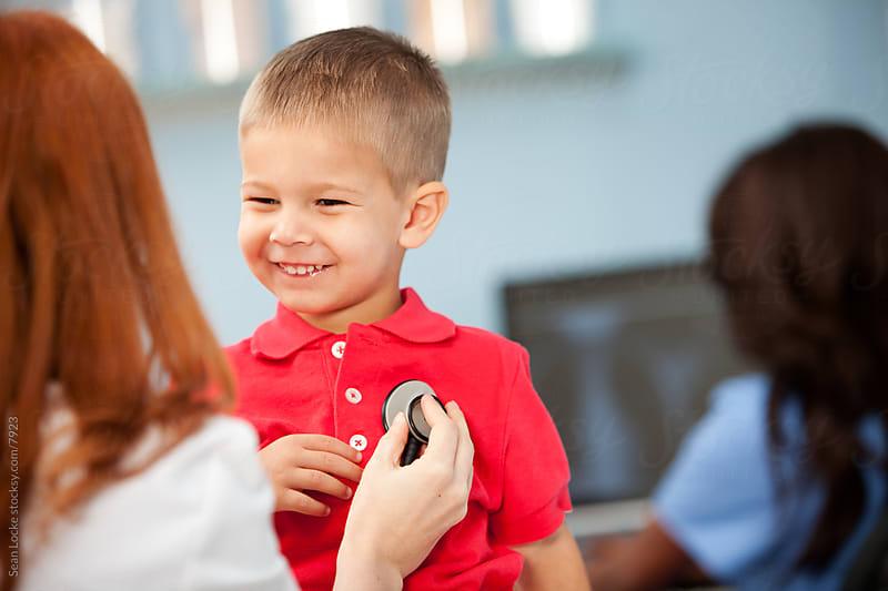 Exam Room: Cheerful Boy at Pediatrician Office by Sean Locke for Stocksy United