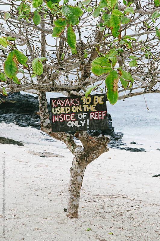Kayak sign on beach, Samoa. by Thomas Pickard for Stocksy United