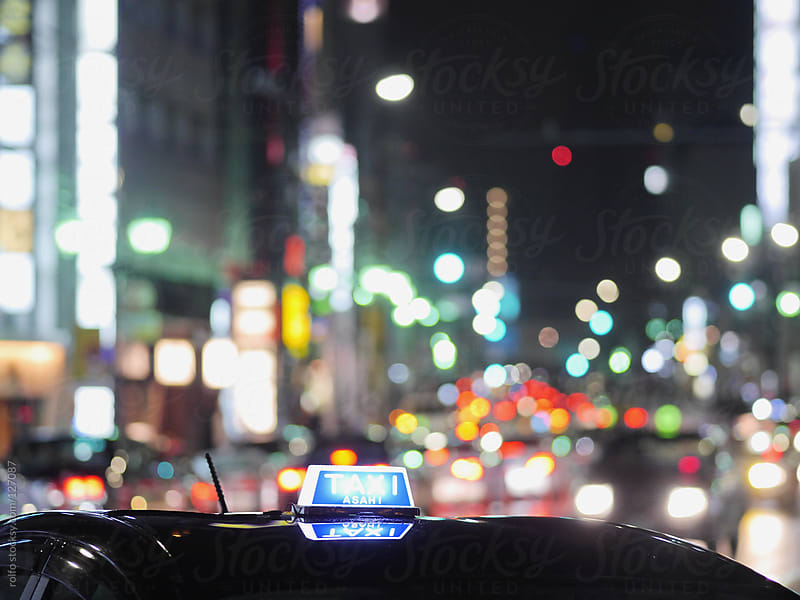 Taxi cab in Tokyo at night by rolfo for Stocksy United
