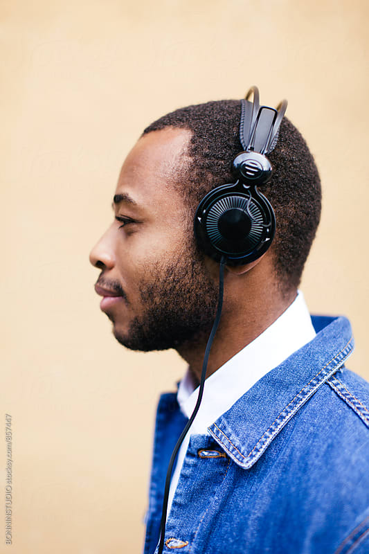 Side view of an african american man listening music with headphone. by BONNINSTUDIO for Stocksy United