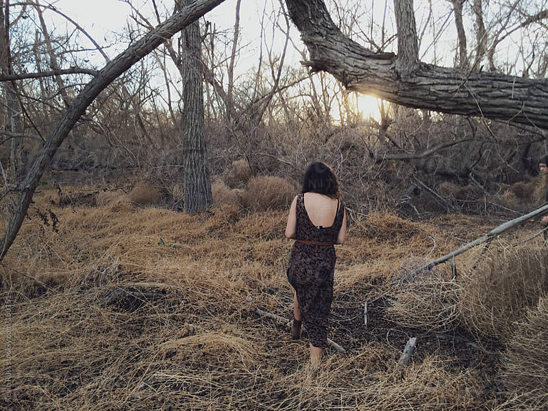 Woman Walking into the Woods by Kevin Russ for Stocksy United