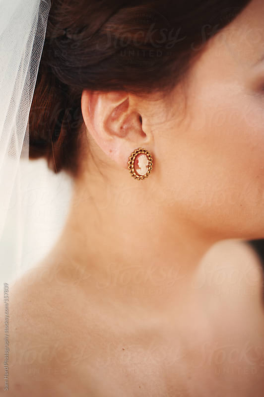 Bride with Earrings by Sam Hurd Photography for Stocksy United