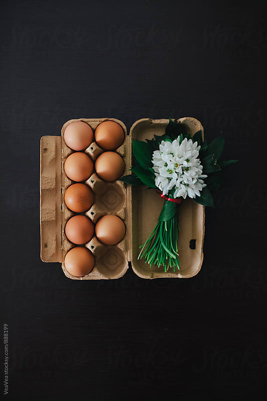 Eggs and a bouquet of snowdrops on the table  by Marija Mandic for Stocksy United