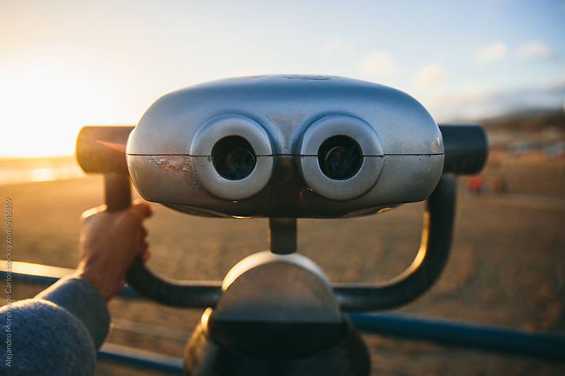 Binoculars first person view in a pier next to a beach by Alejandro Moreno de Carlos for Stocksy United