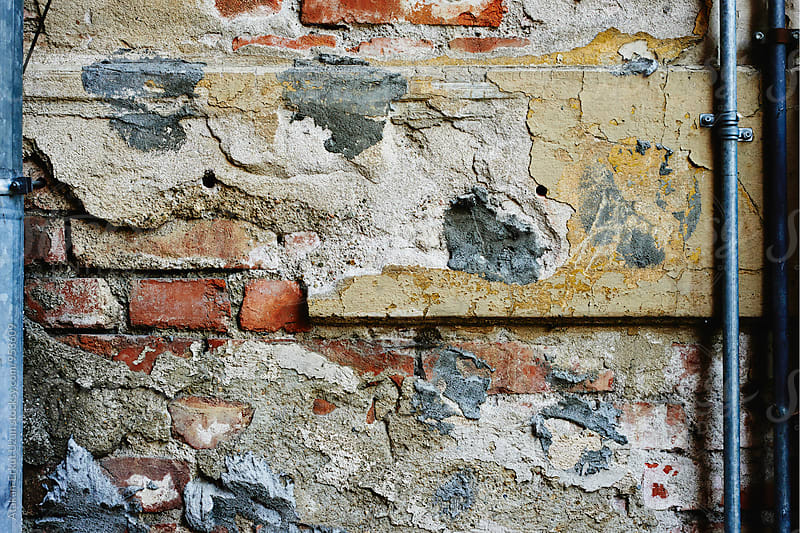 Decaying repaired wall by Atakan-Erkut Uzun for Stocksy United