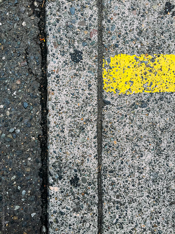 Detail of sidewalk and street curb with yellow strip by Paul Edmondson for Stocksy United