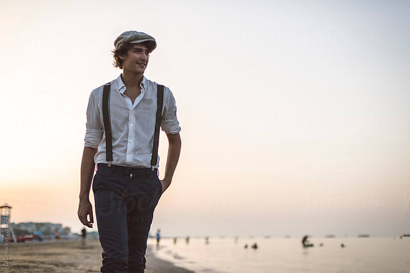 Young vintage dressed man on the beach by Simone Becchetti for Stocksy United