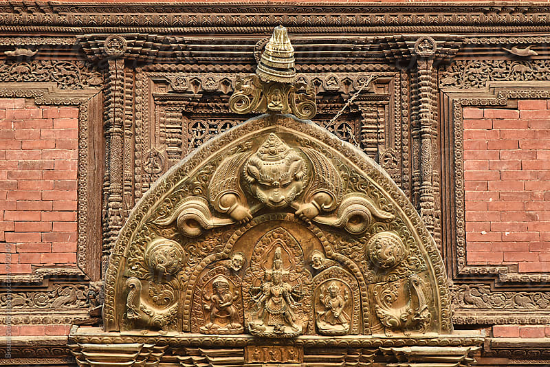 Ancient sculpture on the gate of Patan by Bisual Studio for Stocksy United