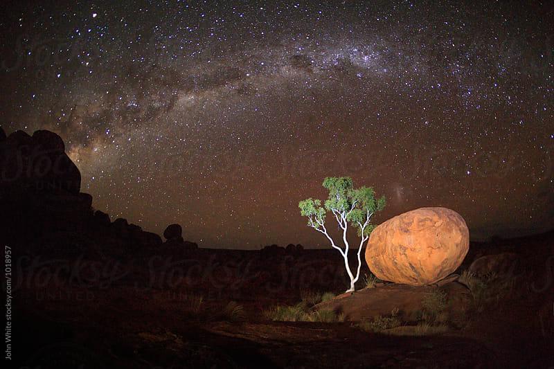 The Milky Way over Karlu Karlu. Devils Marbles. Northern Territory. Australia by John White for Stocksy United