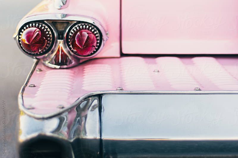 close up of antique pink and chrome car by Deirdre Malfatto for Stocksy United