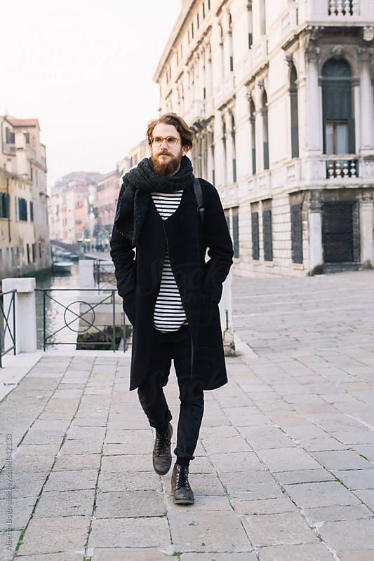 Young Man Walking in Venice Italy by Alberto Bogo for Stocksy United