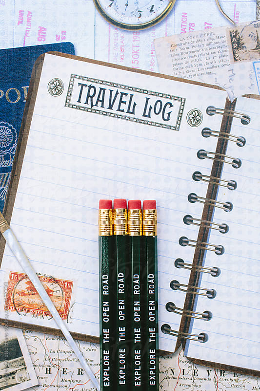 Pencils with a quote on them against a travel background by Kristen Curette Hines for Stocksy United