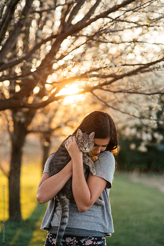 Girl and kitty by Melanie DeFazio for Stocksy United