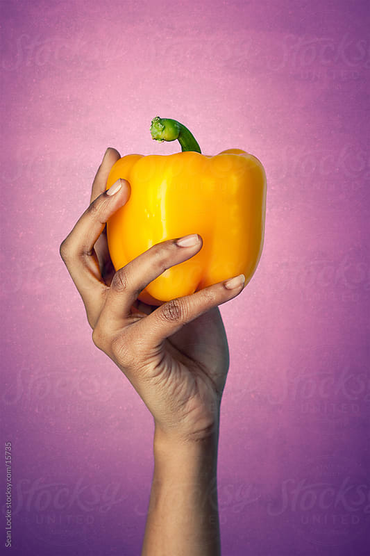 Healthy:Woman Holds Whole Yellow Pepper by Sean Locke for Stocksy United