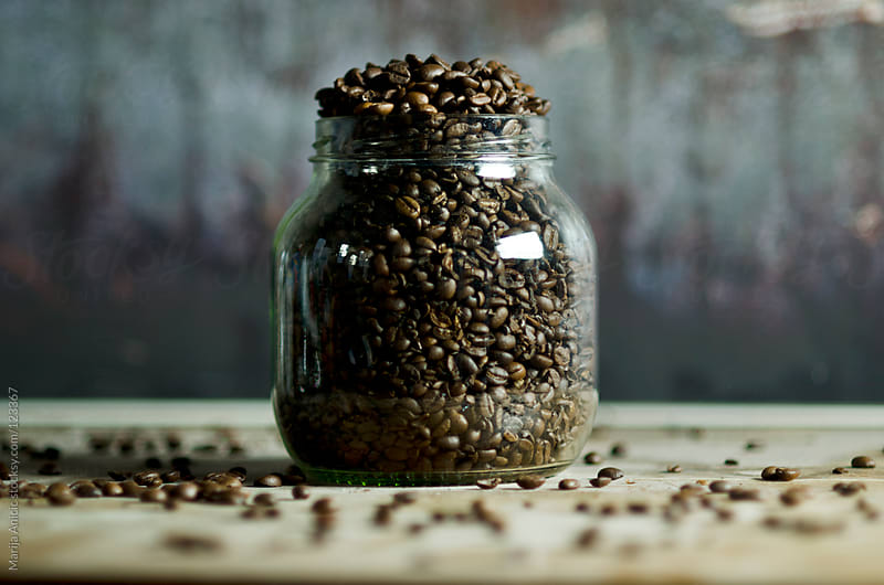 coffee beans  in glass jar by Marija Anicic for Stocksy United