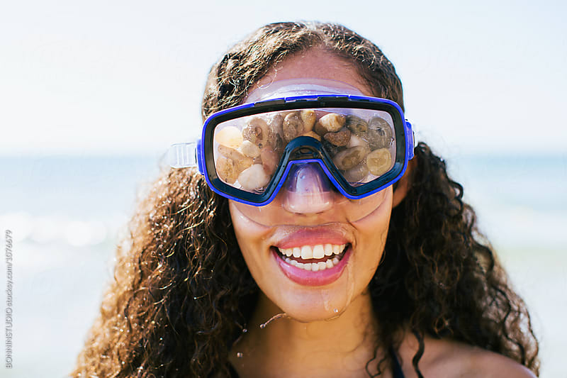 Portrait of a smiling woman with a diving mask. by BONNINSTUDIO for Stocksy United