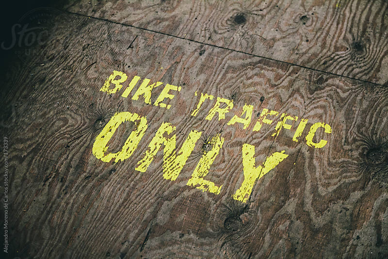 Bike traffic only sign on wood floor by Alejandro Moreno de Carlos for Stocksy United