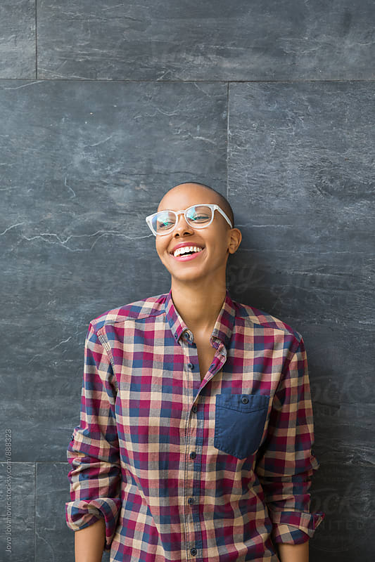 Portrait of a smiling african american woman with reading glasses  by Jovo Jovanovic for Stocksy United