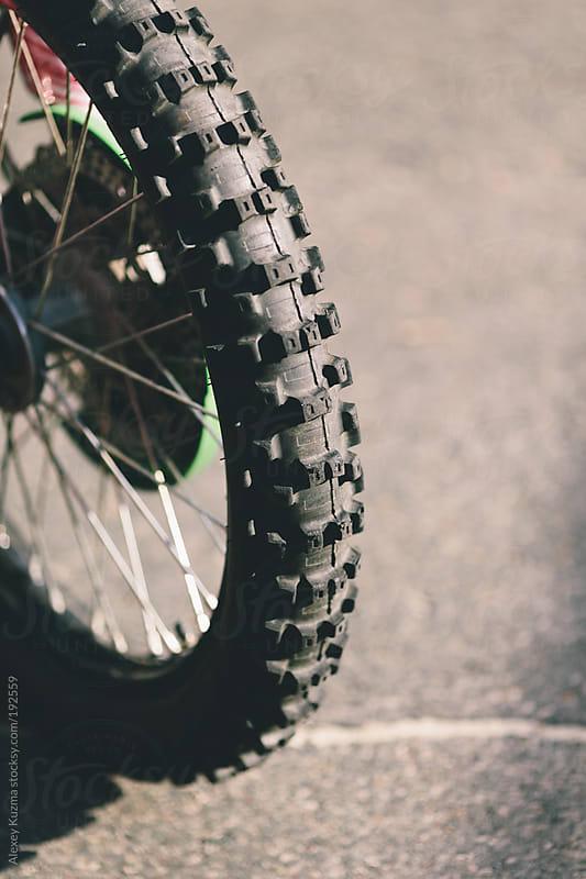 part of  bike wheel by Alexey Kuzma for Stocksy United