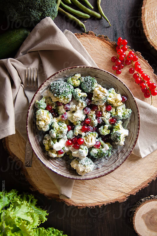 Broccoli salad with natural yogurt and red currant by Nataša Mandić for Stocksy United