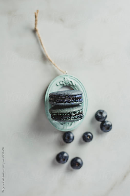Old frame with blueberry macaroons by Tatjana Ristanic for Stocksy United