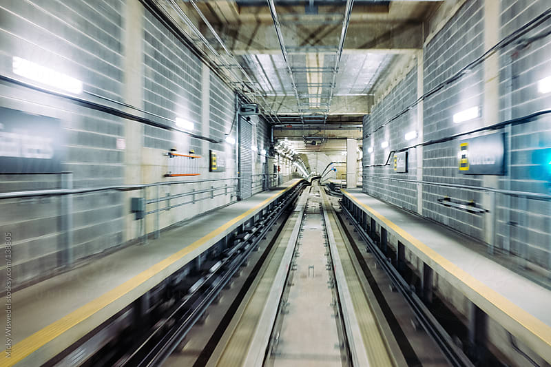 Motion blur of underground rail tunnel by Micky Wiswedel for Stocksy United