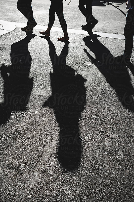 Shadow of people walking on a street by Mauro Grigollo for Stocksy United