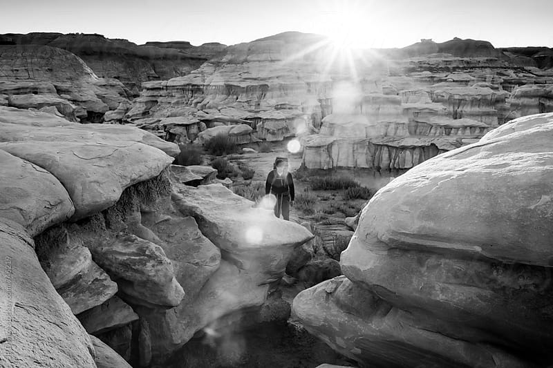 Man Hiking in Bisti Badlands Wilderness Area New Mexico at Sunrise Black and White by JP Danko for Stocksy United