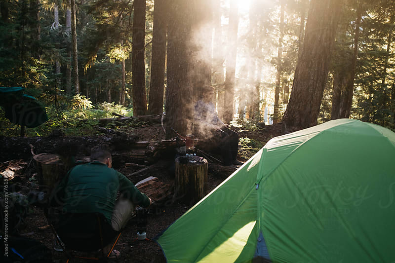 campsite in forest woods at sunset  by Jesse Morrow for Stocksy United