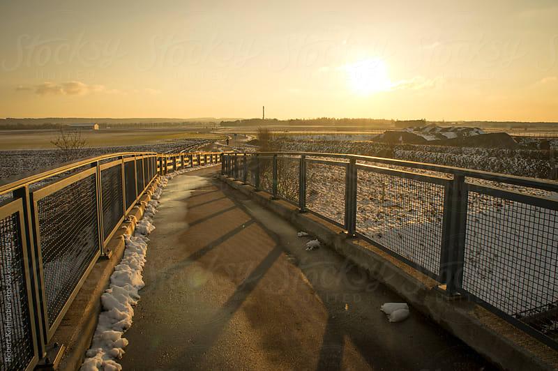 Bridge at dusk in winter landscape by Robert Kohlhuber for Stocksy United