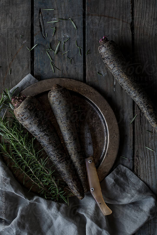 Black carrots and thyme on a metallic plate by KEMA Food Culture for Stocksy United