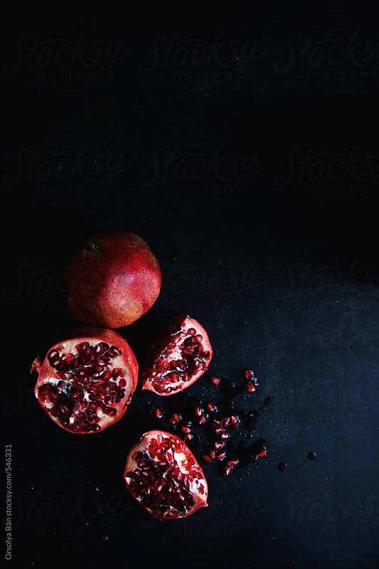 Pomegranate dark background by Orsolya Bán for Stocksy United