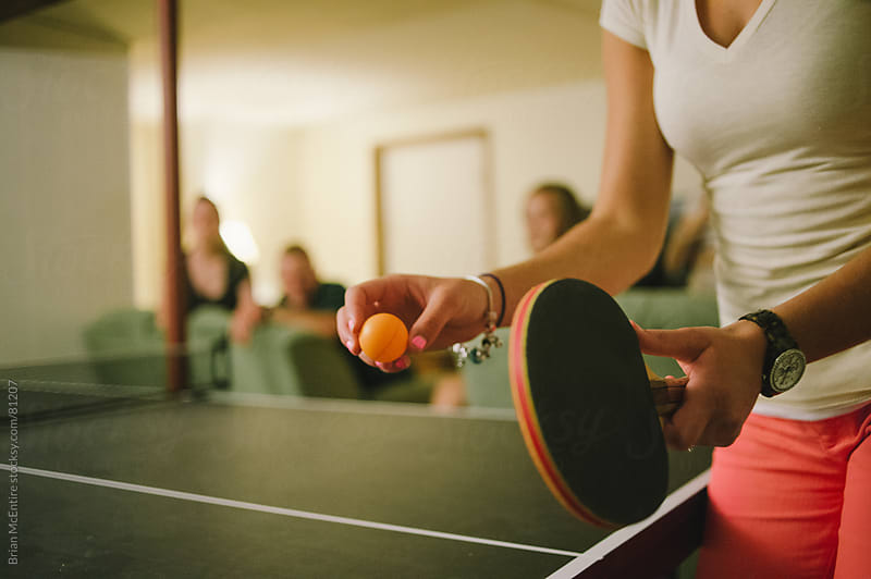 House Party: Table Tennis Match by Brian McEntire for Stocksy United