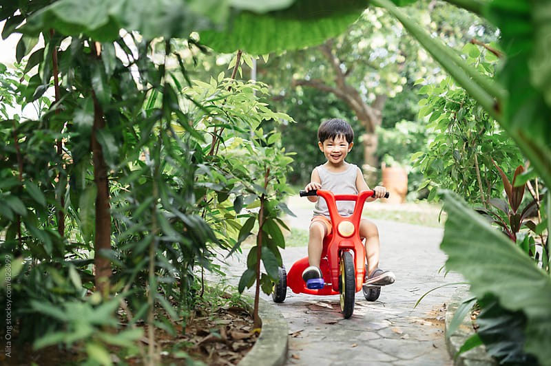 Little boy posing with his bike by Alita Ong for Stocksy United