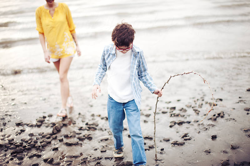 Child and Mother Walking up Beach by Kevin Russ for Stocksy United