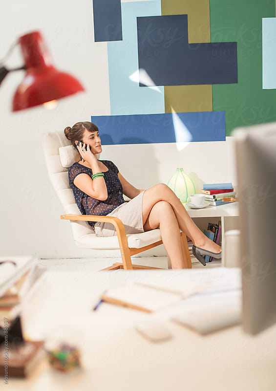 Woman Talking on the Phone in Her Office by Mosuno for Stocksy United