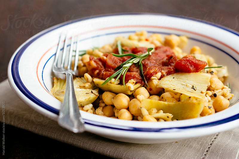 Farro with Chickpeas and Artichokes with Tomato Sauce by Harald Walker for Stocksy United