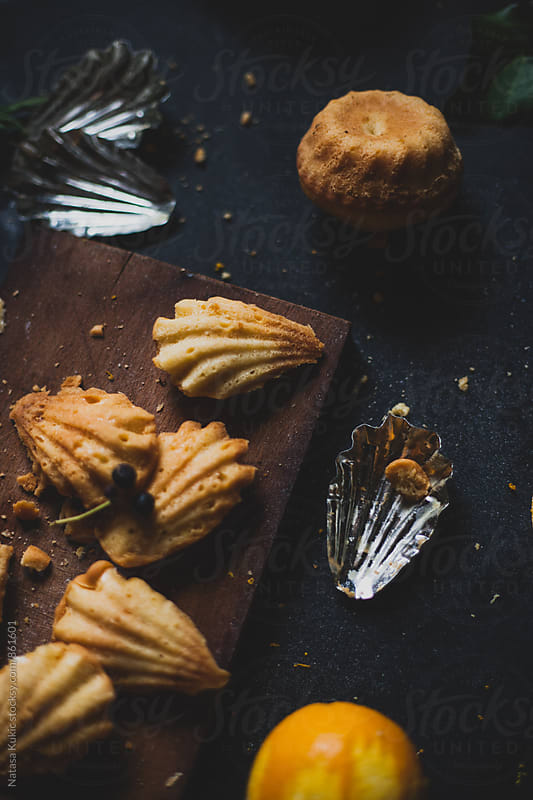 Freshly baked madeleines and mini bundt cakes by Natasa Kukic for Stocksy United