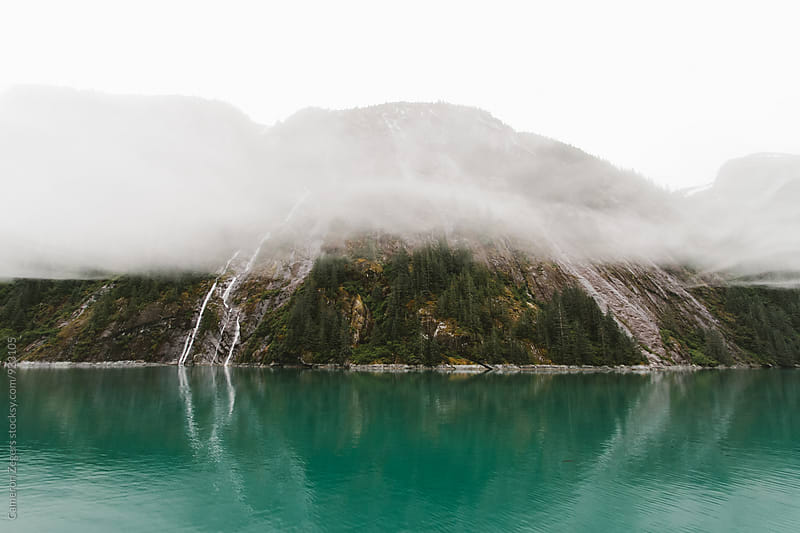 fog and waterfall in Alaksa by Cameron Zegers for Stocksy United