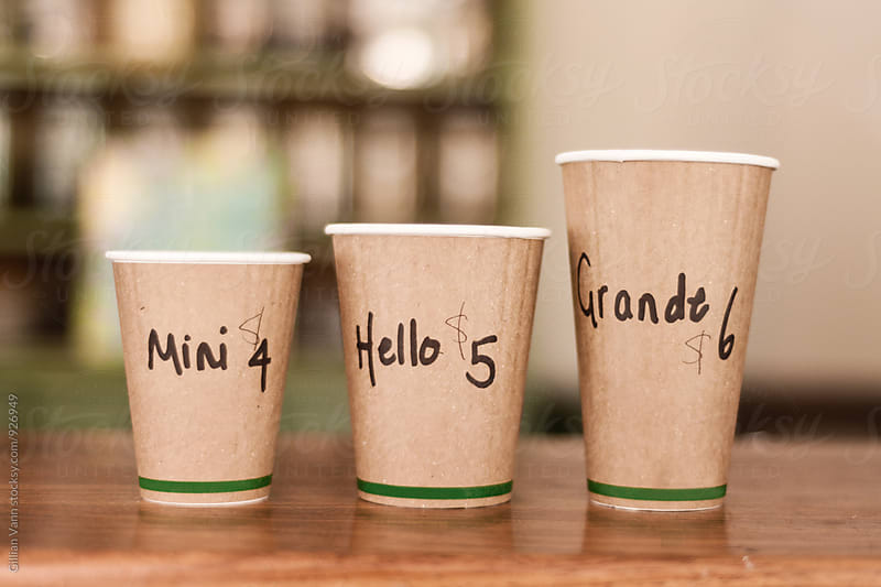 takeaway coffee cups in different sizes by Gillian Vann for Stocksy United