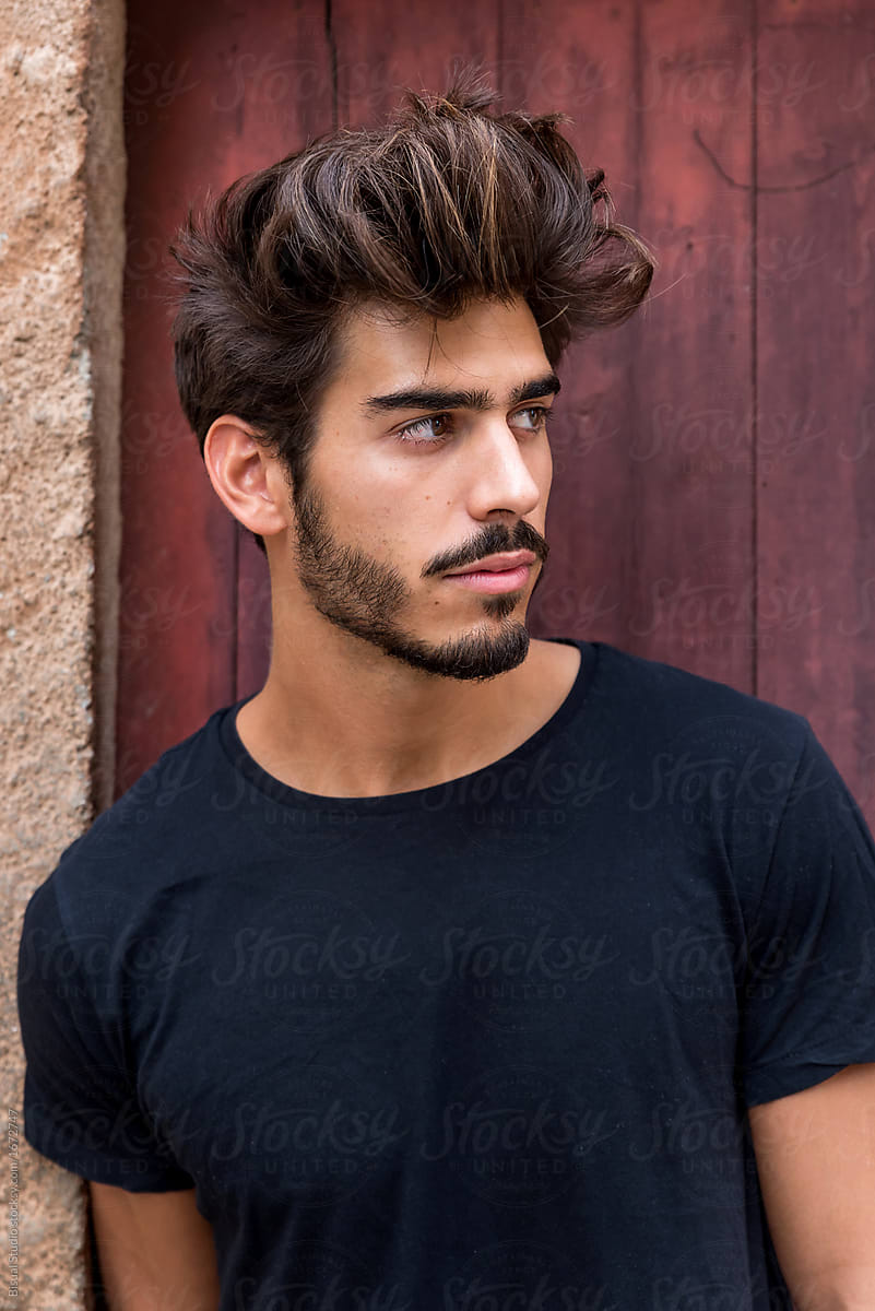 Portrait of a handsome young man with goatee by Bisual Studio - Stocksy  United