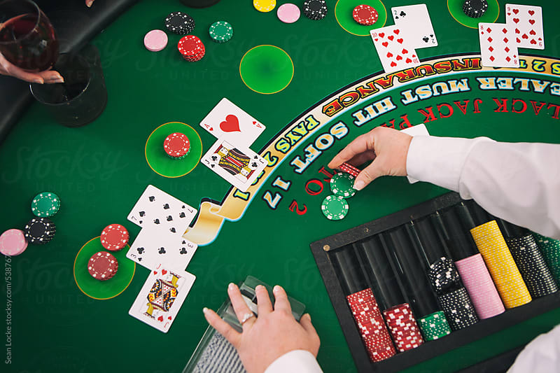 Casino: Dealer Paying Out Winnings In Blackjack by Sean Locke for Stocksy United