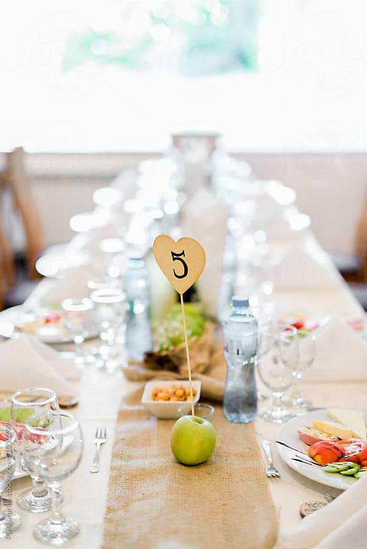 Long table for wedding reception by Pixel Stories for Stocksy United