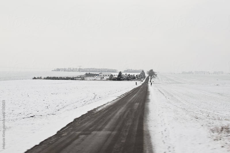 Rural German landscape in winter by Melanie Kintz for Stocksy United