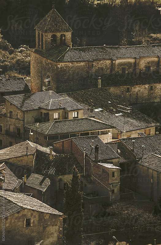 Roofs of rural houses and church.  by BONNINSTUDIO for Stocksy United