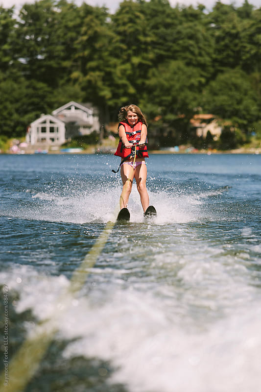 Child Waterskiing in Maine by Raymond Forbes LLC for Stocksy United