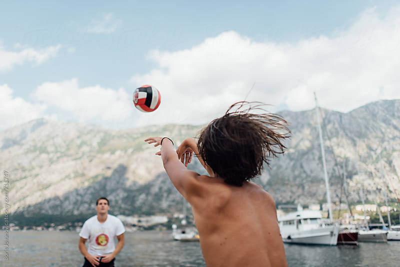 Friends playing volleyball  by Boris Jovanovic for Stocksy United