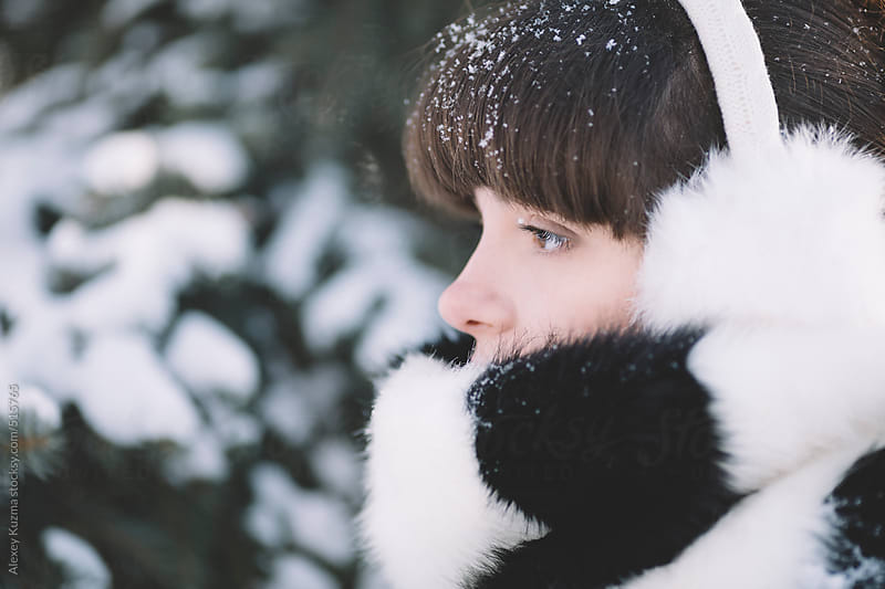 winter close-up of the young woman with the white warm fur . by Alexey Kuzma for Stocksy United
