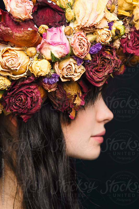 Side view of young woman wearing wreath made of dried flowers by T-REX & Flower for Stocksy United