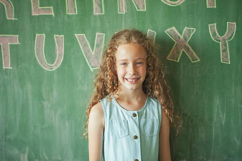 Smiling Schoolgirl by Lumina for Stocksy United